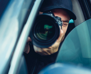 Person in a car with a camera
