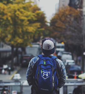 Person with a hat and backpack on