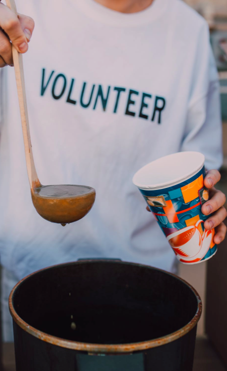 Person wearing a 'volunteer' t-shirt