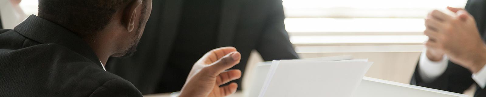 Man speaking in a meeting