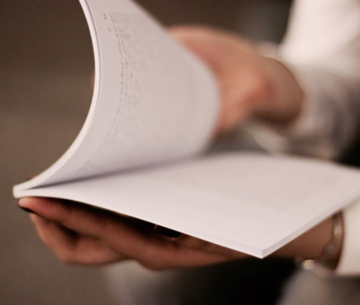 Person flicking through a notepad