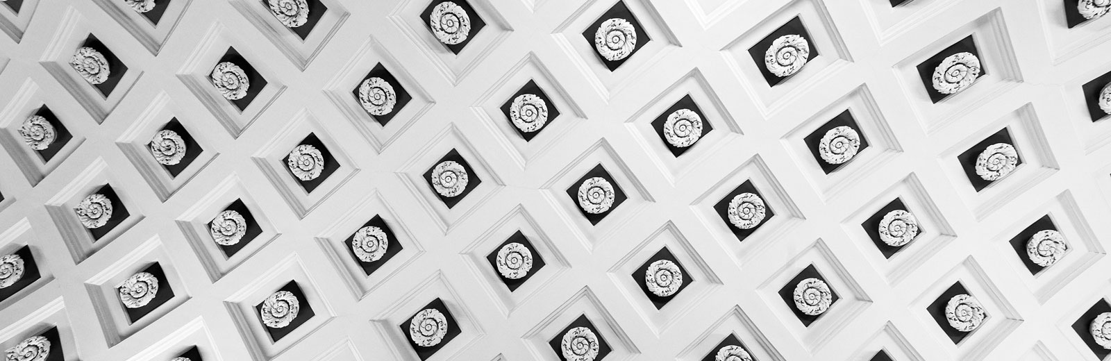 White wall with squares around