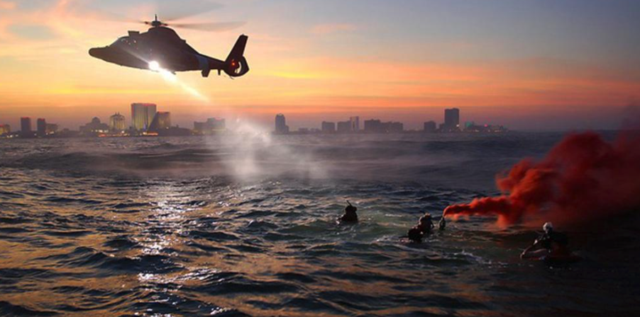 Helicopter flying over water
