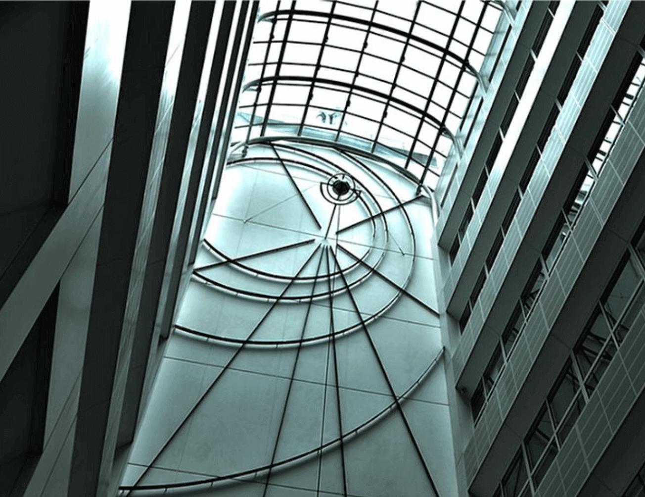 Inside a tall glass building