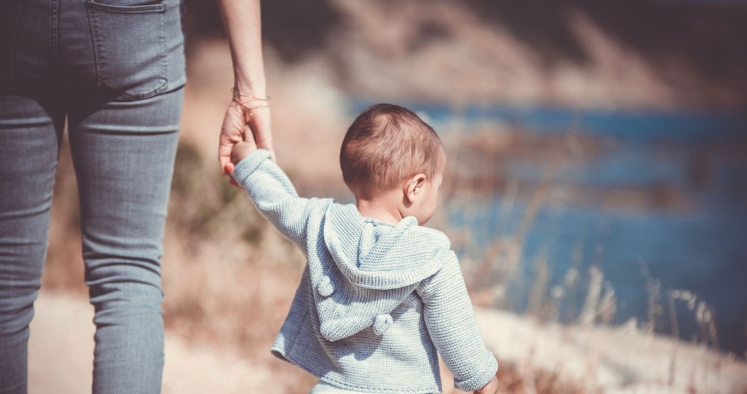 A parent holding a Childs hand