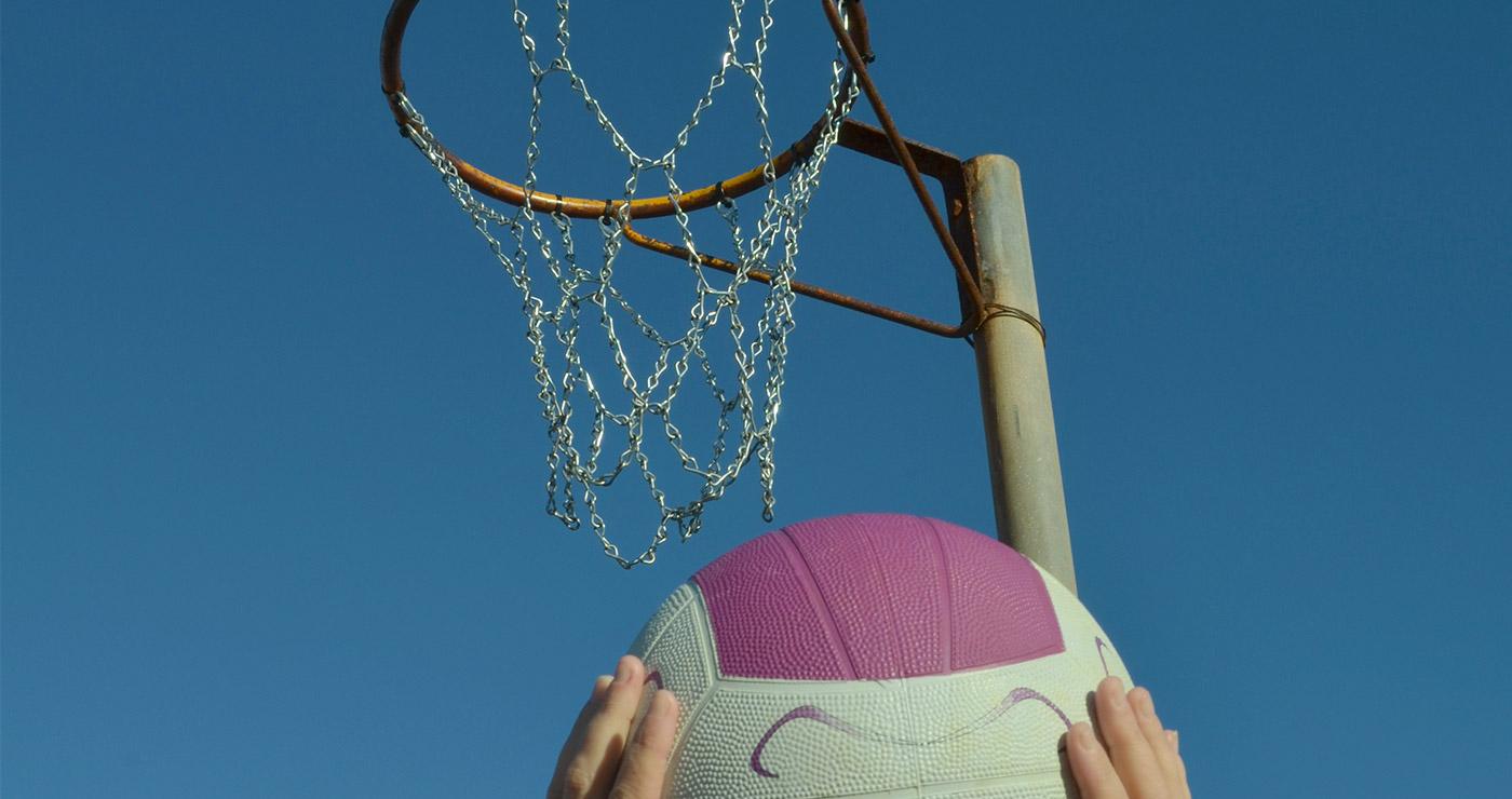 Ball being thrown through a hoop