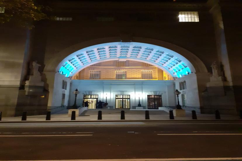 The entrance to MI5 headquarters lit up blue for carers