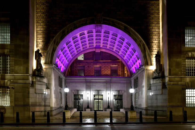 Thames House with archway lit up purple